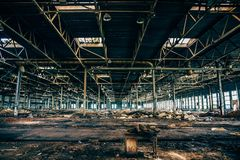 Abandoned industrial creepy warehouse inside old dark grunge factory building. Toned royalty free stock image