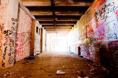 Abandoned industrial hall. With bright light at the end of hall Royalty Free Stock Image