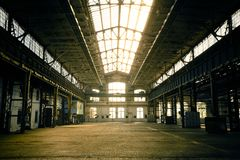 Abandoned industrial interior with bright light Royalty Free Stock Photos