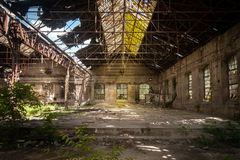 Abandoned industrial interior. With bright light Royalty Free Stock Photography