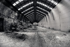 Abandoned industrial interior with bright light Stock Images