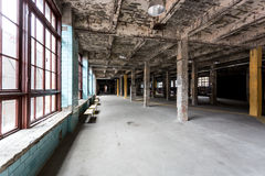 Abandoned industrial interior with hall and big windows Royalty Free Stock Photos