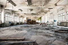 Abandoned industrial loft in an architectural background with rubbish Stock Photo