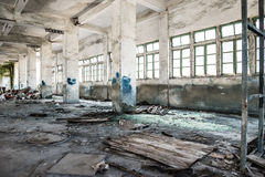 Abandoned industrial loft in an architectural background with rubbish Stock Images