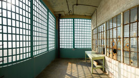 Abandoned Industrial Room. A room in abandoned workhouse, with broken windows, Alcatraz penitentiary, San Francisco, California Stock Photography