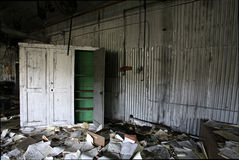 Abandoned industrial workshop. In natural lighting - dirty mess left behind Royalty Free Stock Photo