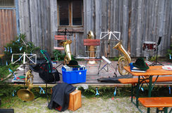 Abandoned Instruments. Musical instruments, along with stands and seating, sitting unattended on a small outdoor stage Royalty Free Stock Photos