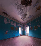 Abandoned interior wide angle shot. Abandoned interior with two windows in corner. Blue wall color. Wide angle shot Royalty Free Stock Photography