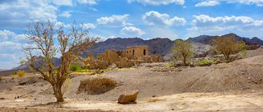 Abandoned Iranian village. The old abandoned Iranian village located in the central part of the country on a background mountains tower Stock Image