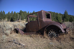 Abandoned Jalopy. An antique automobile, abandoned in the mountains stock photo