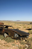 Abandoned Junk Car in Desert Stock Images