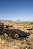 Abandoned Junk Car in Desert Stock Images