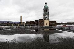 Abandoned Lace Factory and Tower - Scranton, Pennsylvania. An exterior view of the clock tower and factory of the abandoned Scranton Lace factory in Scranton Stock Photo