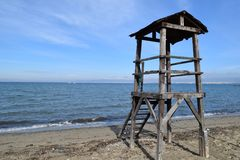 Abandoned lifeguard tower at Peraia, Thessaloniki Greece. Blue sea background stock images