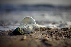 Abandoned light bulbs on the beach Stock Photo