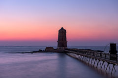 Abandoned Lighthouse in Alexandria. Shore in Egypt during sunset Stock Photo