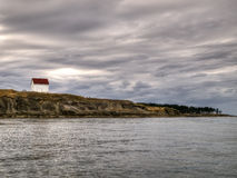 Abandoned Lighthouse Keeper House. An old abandoned lighthouse keeper house and the point of an island in southern British Columbia Stock Images