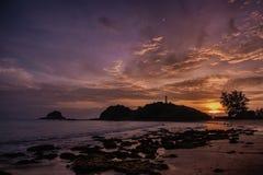 Abandoned lighthouse on a rock in Ko Lanta Stock Image