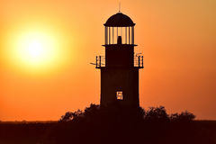 Abandoned lighthouse at sunset on a river Royalty Free Stock Images