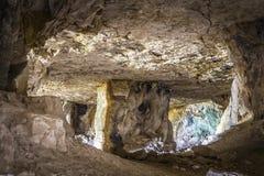Abandoned limestone adit. Old abandoned close-up adit for limestone mining stock images