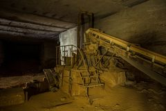 Abandoned limestone mine. Old rusty stone cracking and loading equipment with conveyor belt stock image