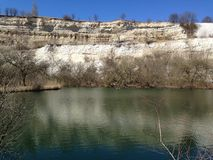 Abandoned limestone quarry in spring Stock Photography