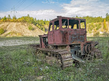 Abandoned loader. Abandoned bulldozer far away from city royalty free stock photography