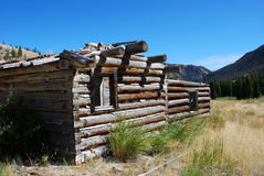 Abandoned Log Cabin. Old abandoned log cabin in the mountain of Wyoming Royalty Free Stock Photography