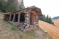 Abandoned log cabin in the Central Rocky Mountains of Montana USA royalty free stock photo