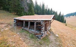 Abandoned log cabin in the Central Rocky Mountains of Montana USA stock image