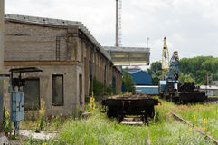 Abandoned looking industrial shipyard with large crane and railtracks Royalty Free Stock Image