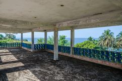 Abandoned luxury lodge with terrasse overlooking ocean, traces of civil war, Robertsport, Liberia, West Africa royalty free stock photo