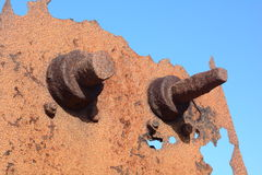 Abandoned machinery. A photo of some rusty abandoned machinery bolts Royalty Free Stock Photo