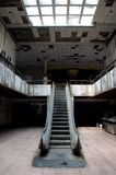Abandoned mall in Bangkok, Thailand. With a ground floor and a first floor and an automatic stairs in the middle Royalty Free Stock Photography