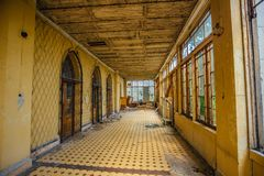 Abandoned mansion interior. Building terrace with tiled floor royalty free stock image