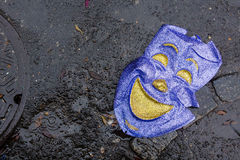 Abandoned mask. Abandoned carnival mask on the street after Mardì Gras in New Orleans Stock Photo