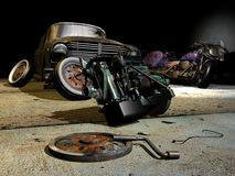 Abandoned Mechanic workshop. Old and broken car, motorcycle, motor, tires and tools on a dirty floor Royalty Free Stock Photo