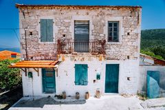 Abandoned Mediterranean house on the top of the green hill in the middle of Greek island.  royalty free stock photography