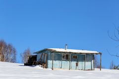Abandoned metal house in winter stock photo