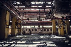 Abandoned metallurgical excavator plant or factory interior, industrial warehouse building waiting for a demolition. Toned stock image