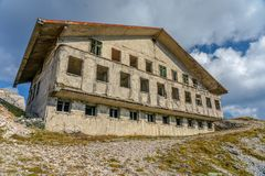 Abandoned Military Barracks on the mountain side in the clouds royalty free stock image