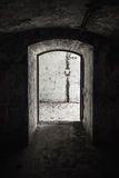 Abandoned military bunker interior. With concrete walls and empty doorway Royalty Free Stock Images