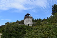 Abandoned military watchtower falling apart. Royalty Free Stock Images