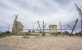 Abandoned military zone with rusty spiked fence Stock Photos