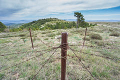 Abandoned military zone with rusty spiked fence Royalty Free Stock Photography