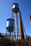 Abandoned mill water towers Royalty Free Stock Photo