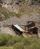 Abandoned mine. Old abandoned mine shaft and buildings on a mountain in Colorado, America stock image