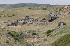 Abandoned Mine in the American Wild West. Abandoned gold or silver mine buildings in the hills of Wyoming in the American wild west. Near Yellowstone National Stock Images
