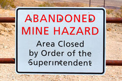 Abandoned Mine Hazard Sign. Sign warning of an Abandoned Mine Hazard in Death Valley National Park stock images