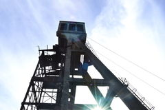 Abandoned mine headframe. Light image on abandoned mining headframe Stock Image